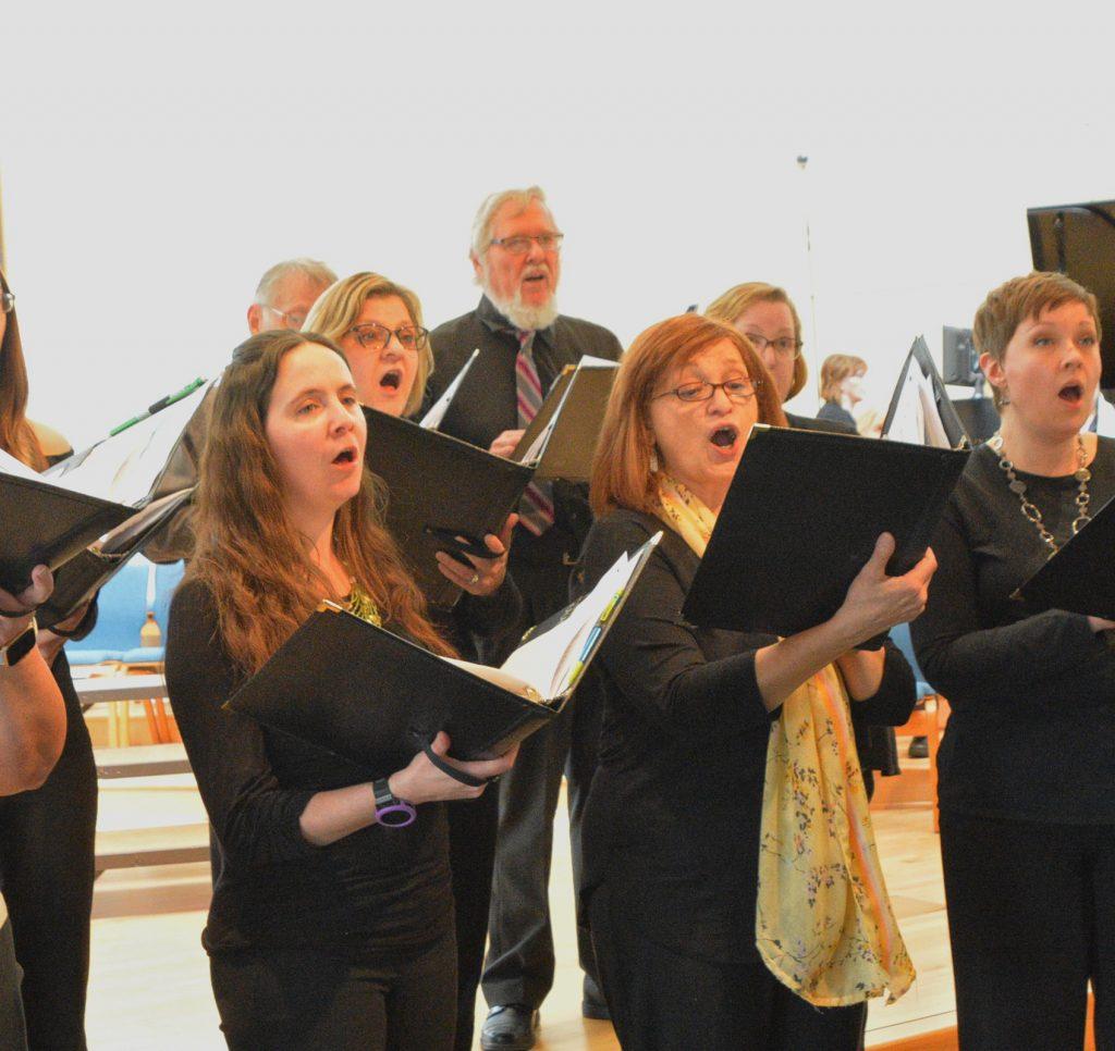 Prairie Voices members singing at rehearsal.
