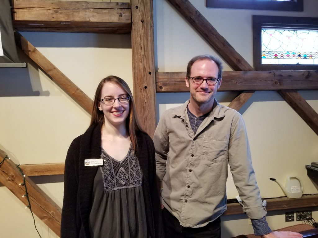 Chelsea Musson and Caleb Willitz standing in the sanctuary.