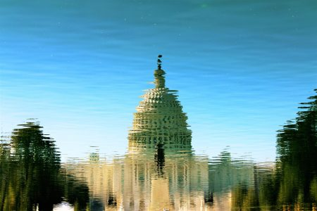 US Capital Building reflected in a pool of water